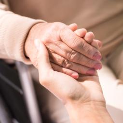 holding-patients-hand-PBHJXMB
